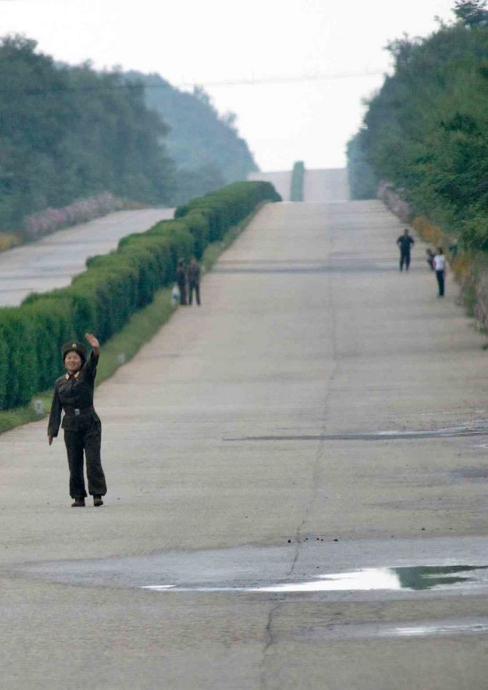 In North Korea, people need permits to travel from one city to another, and public transport barely exists. Even soldiers have to hitchhike to travel.
