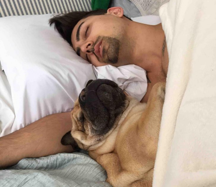 "4. ""My girlfriend takes pics of me sleeping. My dog doesn't snuggle like this while I'm conscious."""