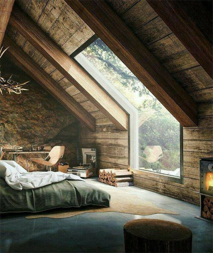 29. Wonderful wooden loft with a large window