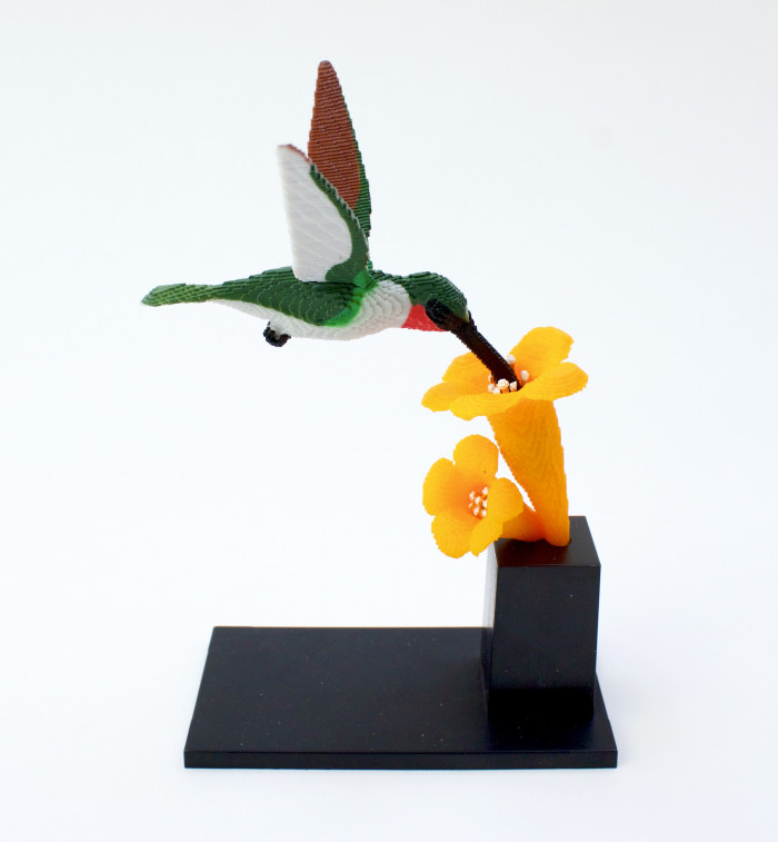 14. He has miniature models of his creations.