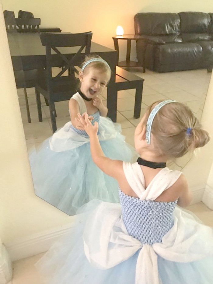 The littlest princess admiring her reflection