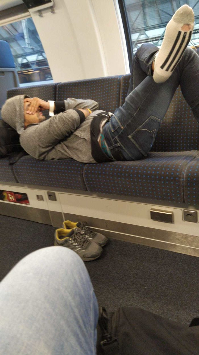 2. This guy was asked to move, but told other passengers he was 'too tired' to give up any of the 4 seats he took up.