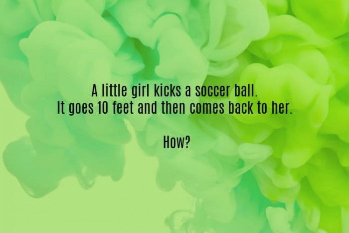 #1. A little girl kicks a ball.
