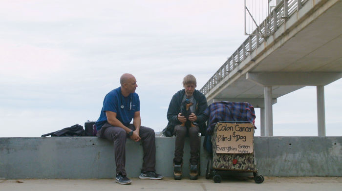 We can see the Street Vet helping a man with colon cancer and his dog, Crazy Girl