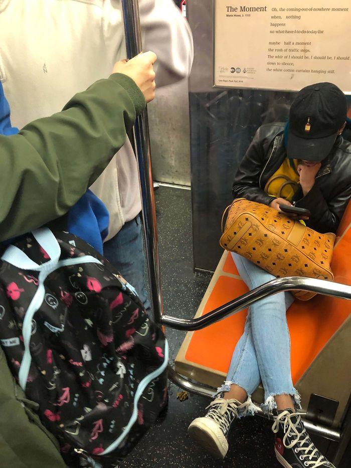 1. Stretched out on a crowded train