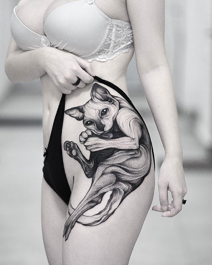 2. The purr-fect tattoo exists.
