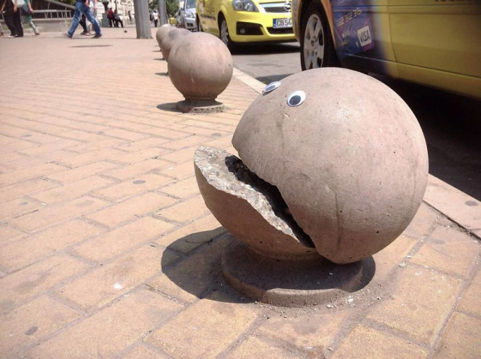 1. This concrete ball looks like it is crying out for help.