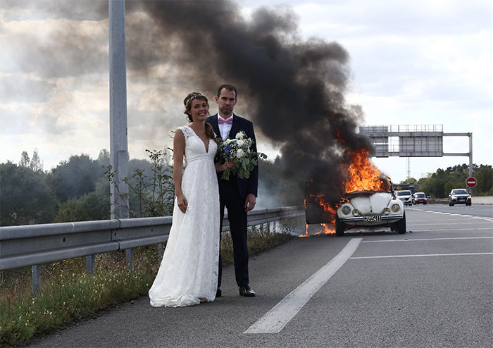 #9 Just Married Couple In Front Of Their Burning Car