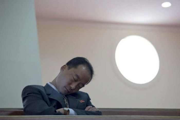 This photo of a government official falling asleep in a Christian church is forbidden because the guides say it portrays the officials in a negative way.