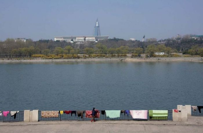 People had hung these carpets up to dry on the rails beside the Taedong river. Pictures of them were forbidden because you can faintly see a statue on Kim Il-Sung in the background.