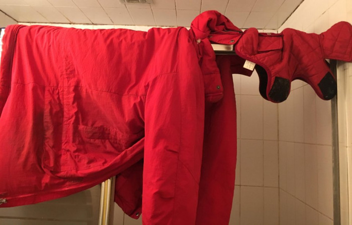 This dad didn't want a dog. Now he hangs up the dog's coat next to his to dry after it rains.