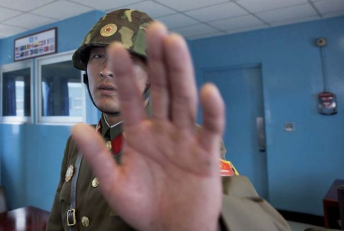 This picture was taken in the de-militarized zone of North Korea. As you can see, this soldier objected to this photo.