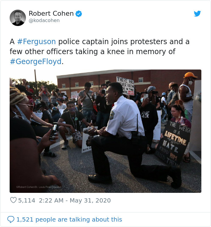 19. Police captain taking a knee