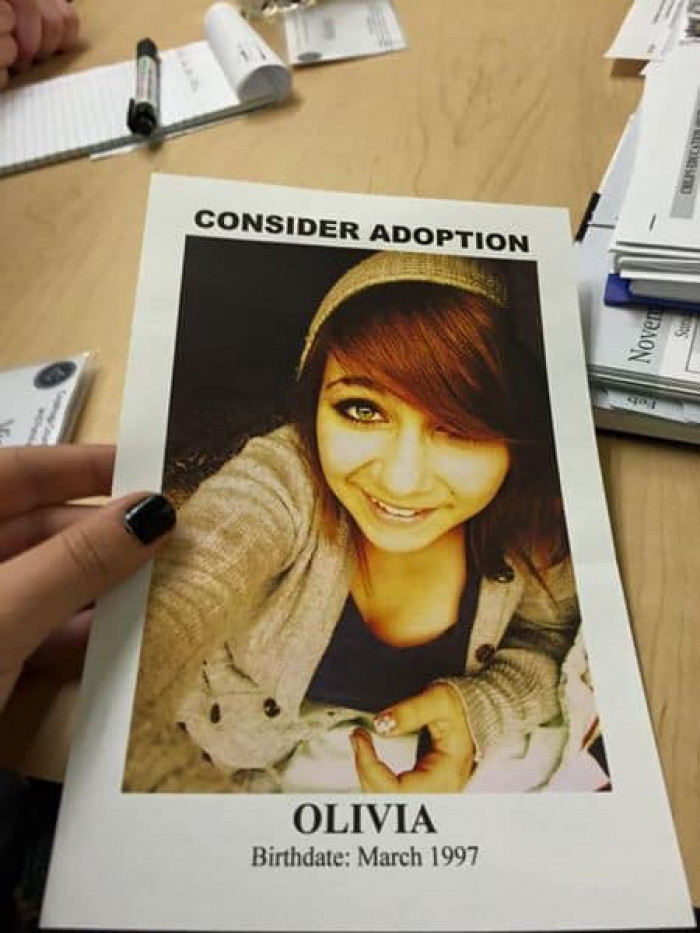 Along with her status, Olivia shared a photo of a flyer that was handed out to prospective adopters when she was a teenager.