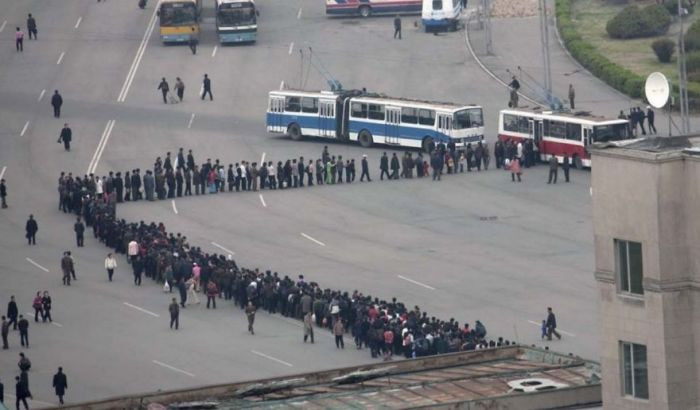 Only in North Korea are the lines this long. These people are all waiting to get onto the bus.