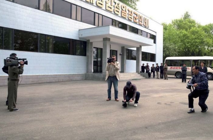 Eric and his personal crew, as well as a local North Korean photographer, had worked together and filmed the entire trip together. However, on this day, the government sent out ANOTHER North Korean photographer to film ALL of them (even the North Korean photographer already accompanying the crew).
