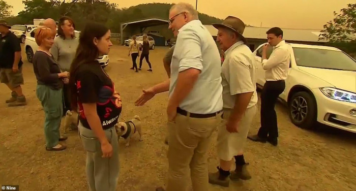 One local didn't want to shake Prime Minister Scott Morrison's hand until he pledged more help to volunteer firefighters