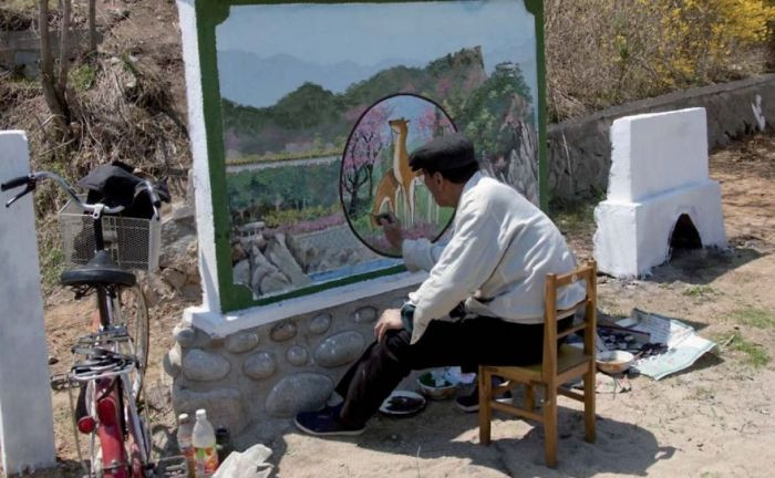 When Eric took this picture of an artist working on a new mural in Chilbo, everyone yelled at him not to take it- just because it wasn't finished yet.