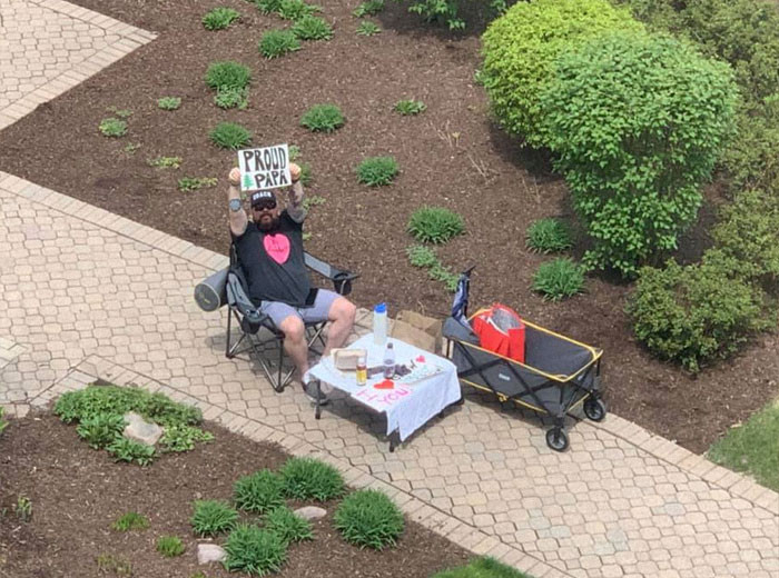 Bob cannot visit his wife because of the coronavirus situation, so he is setting up date nights in front of her window