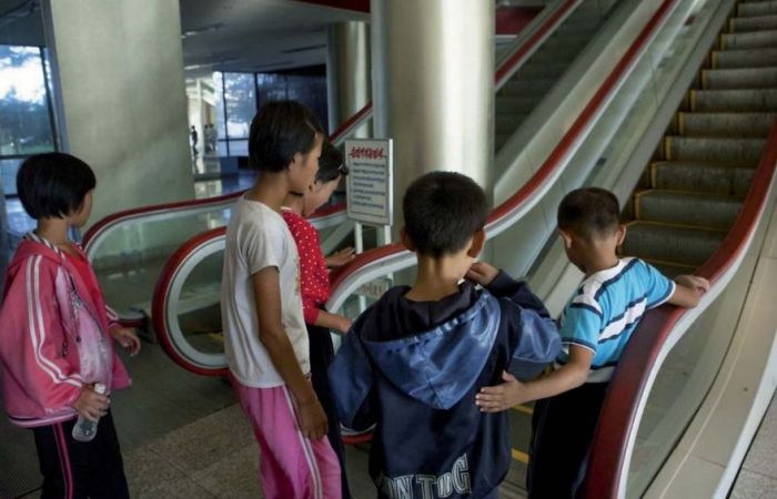 These children at a summer camp run by the Young Pioneer Corps had never seen escalators before and were too scared to use them.