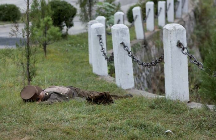 This soldier was caught asleep in a field.