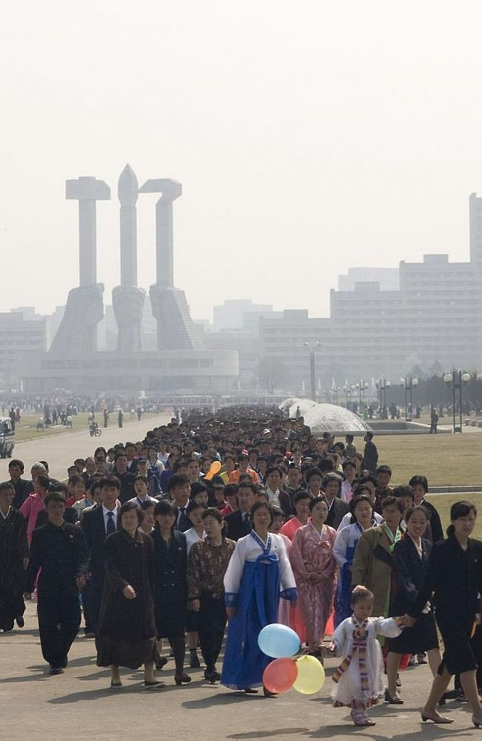 North Koreans lining up to visit monuments on one of the days of the annual Kimjongilia festival.