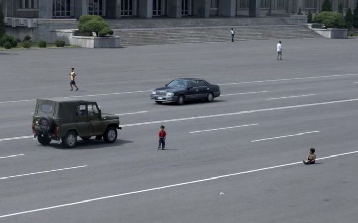The citizens used to rarely see cars, so they still haven't adjusted to it as cars have become more widespread. Children still play out on the main roads as if nothing has changed.