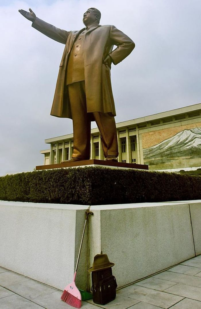 This photo is forbidden because a broom is pictured at the base of this statue of Kim Il-Sung (Kim Jong-Un's grandfather and former North Korean leader).