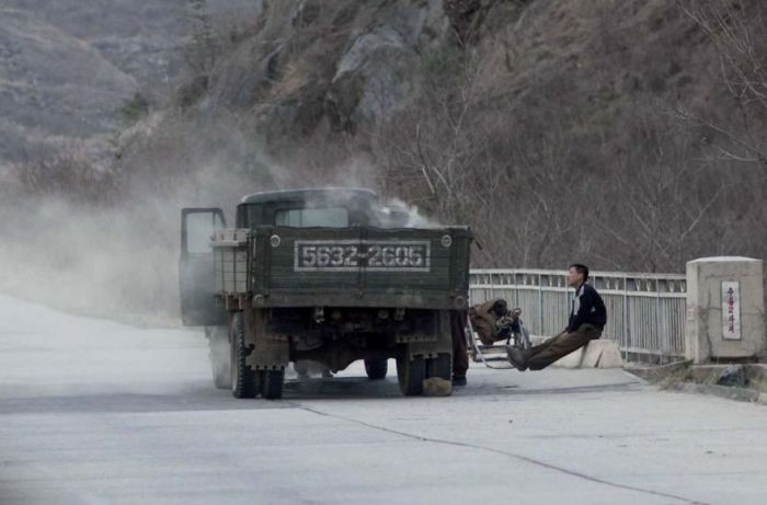 Due to North Korea's implied lack of resources, they have a difficult time obtaining oil. Here, you can see a truck loaded with coal, to be used as fuel.